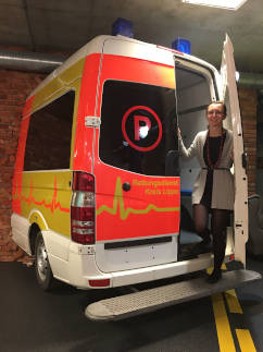 Agnieszka go out from an ambulance in the DocPlanner office